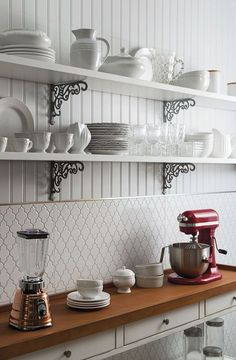Bit of fun or 'ethnic' tile. Brassy cap line, and plank wall behind shelving. Add earthquake rails to all shelves.