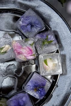 Photo by Chia Chong •WHY I LOVE IT: Because it's a cool idea. Sometimes the idea alone makes the photo.  •STYLING TIP: Shooting on the pewter Juliska Plate made the water I spooned on after the ice cubes were arranged really stand out. Also, if I had used all purple flowers, it would not have been as strong of a shot. The pop of pink really makes it beautiful.  Great for a special party!