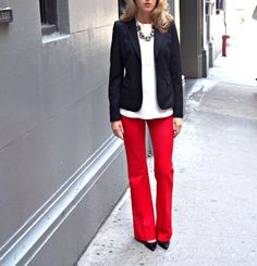 White sweater/shirt/blouse, red slacks