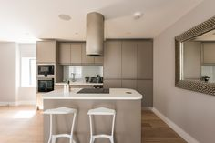 A contemporary Metris kitchen in soft grey matt finish. The Madison Apartments, Fulham Fulham, Apartments, New Homes, London, Contemporary, Grey, Kitchen, Table, Furniture