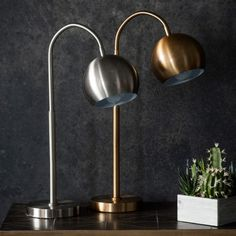 Stylish table lamps with a metal flexible arm and adjustable head in a brushed nickel finish.  Available in Bronze & Brushed Nickel.  Perfect for precision lighting…