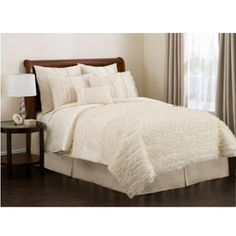 i love the Lush Decor Ivory Paloma 4-piece Comforter Set, but i'm not sure it goes with my canopy bed (http://www.overstock.com/Home-Garden/Excel-Queen-size-Canopy-Bed/2039800/product.html).  it's so delicate and ruffly.  i like it color-wise, because all canopy images i have seen have solid white/cream bedding. thoughts?