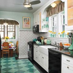 A ca. 1930 kitchen is perfect for this house—and the backdrop for its owners' collection of blue-green ceramics.: