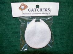 Here is my invention for displaying baseballs in glass cases that I call CATCHERS.  They are for sale on eBay, just search under CATCHERS baseball display.  They take up less space than the traditional baseball cubes, will not trap gases around the baseball which can prevent deterioration of the autograph, and can prevent ball discoloration.
