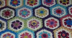 It'll be blooming flowers in your home when you crochet this Colorful Floral Granny. Hexagons are crocheted and joined together to form a beautiful crocheted afghan. This should be your one and only reason to know how to crochet a blanket.