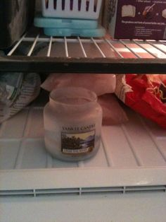 Reusing Yankee Candle jars.. Just put jar in freezer for an hour or so and wax pancake will just drop out.