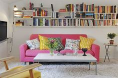 Book shelves over the sofa for space-saving storage