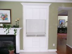 Built-in Entertainment Center--idea for living room.  Like the crown molding and drawers/cabinets on the bottom.