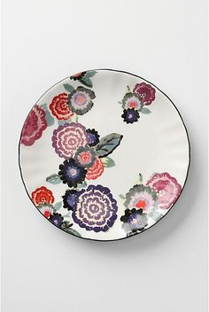 """Plate. Anthropologie Plate. Zinnia Thicket Salad Plate, White. Picked fresh from the garden, cheery petals brighten glazed earthenware. #Earthenware Hand wash. 8"""" diameter. #073141 $7.95 was 12.00 Color:White http://re.pn/b/bneK"""