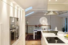 Scandinavian Design: Amazing Duplex Penthouse Renovation in Sweden | HomeDSGN The colors make this scene come alive.