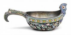 Fine Russian enameled silver kovsh  11th artel, moscow, 1908-1926, probably ivan alexeyev  Low oval form showing floral, scroll and dot design in shades of green, pink, yellow, cobalt blue, orange, purple, and turquoise enamels, on a textured ground.  H: 1 7/8, W: 4 1/2, D: 2 1/4 in. 2 oz.