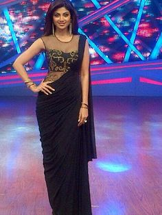 Shilpa Shetty on the sets of Nach Baliye semi finals in a gorgeous black Sonaakshi Raaj saree gown Indian Wedding Guest Dress, Indian Wedding Outfits, Indian Outfits, Wedding Dresses, Indian Clothes, Saree Wedding, Indian Blouse, Indian Sarees, Saree Gown