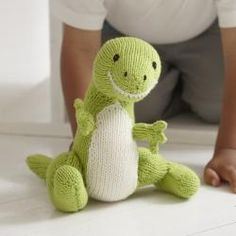 Free Dinosaur Toy Knitting Pattern found over at Canadian Living! A friendly T. Rex stuffed animal makes the perfect toy for the little ones in your life.By Baby Knits Made Easy from DK Publishing. Find the free dinosaur knitting pattern here: link Animal Knitting Patterns, Stuffed Animal Patterns, Crochet Patterns, Dress Patterns, Knitted Dolls, Crochet Toys, Crochet Bear, Knitting Projects, Crochet Projects