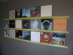 "DIY record rails made with 1x2"" pine strips and bevel casing trim, both cheap and easy to get at the hardware store. Love this idea, turn your records into wallpaper!"