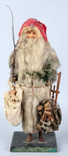 Crepe paper, cotton, mohair and scrap Santa figure. I would like to add him to my collection!