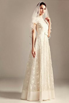"Lovely, Lace ""Vintage"" Wedding Gown With Lace Illusion Bateau Neckline & Short Sleeves, Thin Ribbon Belt At Natural Waist, & Solid Hemline; Shown With Coordinating Satin Edged Mid Length Silk Veil; by Temperley London>>>>"