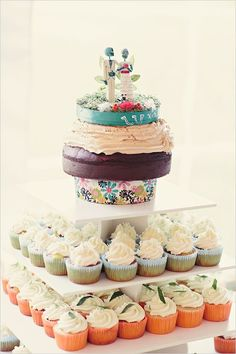 Colorful cupcake tower with cake on top #wedding #weddingcupcakes #cupcakes #diywedding #cupcaketower