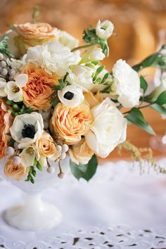 Peach floral #centerpiece with #gardenroses and #anemones, yum :) Photo by Hudson Nichols Photography http://ruffledblog.com/peach-and-emerald-wedding-ideas/