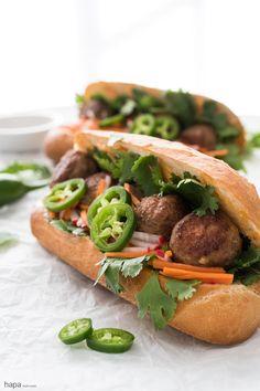 Incredibly moist and flavorful Meatball Bánh Mì Sandwich with fresh veggies and creamy Sriracha mayo on a crispy bun.