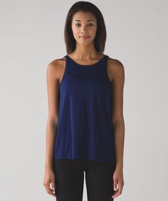 This lightweight tank was  designed with a low scoop back  to keep you cool during your  workouts.