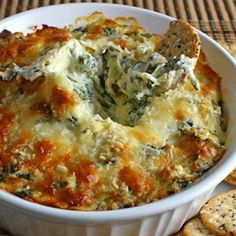 Hot Spinach and Artichoke Dip  - (because i can never find the recipe when i want it & this pix is pretty). i use 1 full bag chopped spinach (extract as much water as possible) 8 0z cream cheese equal parts SC & mayo  1/3 c approx. spicy jack cheese gives nice bite, can add dill, or other seasoning for flavor.