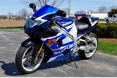 "K1 1000, pc3, full yoshi exhaust, 8"" stretch, hot-bodies undertail, custom tail light, custom blue windscreen, led headlights ect."