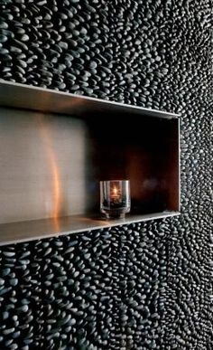 New bathroom obsession: stacked black pebble tile walls.