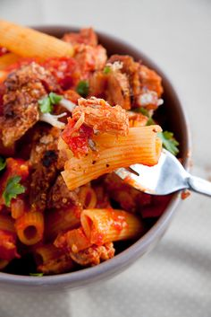 A clever and delicious way to use up the left-overs from Sunday's roast. Delicious, moist pork in a spicy tomato sauce served on pasta.