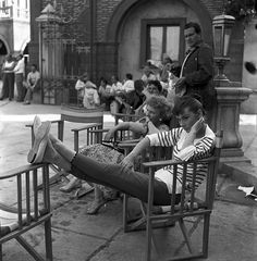 A photo of Audrey Hepburn on the set of War  Peace 1955, look as chic as ever in a Breton striped shirt.