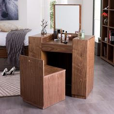 The Hideaway dressing table is a beautifully neat, self-contained unit with a built-in chair, mirror and plenty of storage space for all your accessories and paraphernalia.