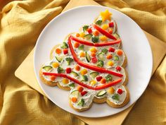 Appetizer-- ranch/cream cheese spread over base of canned biscuits, decorated like Cmas tree with chopped and sliced fresh veggies :)