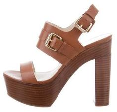 Brown leather Michael Michael Kors platform sandals with stacked heels and gold-tone buckle closure at ankles. Brown High Heels, Leather High Heels, Brown Shoe, High Heel Boots, Leather Sandals, Shoes Sandals, Bedroom Heels, Michael Kors Platform Sandals, Heeled Mules