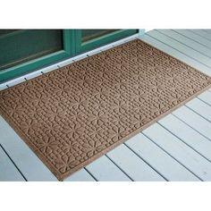 Aqua Shield Stained Glass Mat Size: 3' x 5', Color: Medium Brown by Bungalow. $79.99. 707510035 Size: 3' x 5', Color: Medium Brown Features: -Surface material: Premium 24 oz. polypropylene.-Origin: USA.-Green friendly with over 20pct recycled rubber backing.-Low profile design allows most doors to glide easily over it.-Will not crush, fade, mold, mildew or rot.-Anti-static and flame resistant.-Suitable for multiple uses throughout your home, outdoor space, workplace or garage...