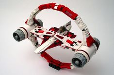 https://flic.kr/p/aGaie8   Hyperdrive Transport Ring   A LEGO model of the Hyperspace Transport Ring, as seen in Star Wars Episode II - Attack of the Clones. The transport ring is used by Jedi Starfighters and other small ships to achieve hyperspace travel capabilities. This was one of the first LEGO models I built after leaving my first dark age, all the way back in May 2002. It was designed specifically to fit around the official Jedi Starfighter model at the time, set number 7143, and…