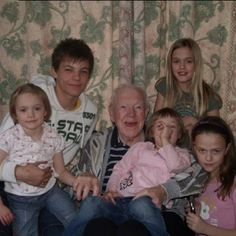 . Louis with his sisters and his grandfather. How cute!
