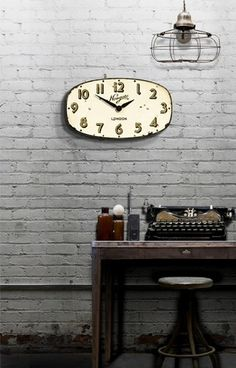 Newgate Clocks Shop Wall Clock is wonderfully vintage!  A great wall clock for a small space, this clock has an oval composite wood dial that has been expertly designed to show signs of aging and faux rivet marks. | #ticktock | $80 | thepicketfence.com
