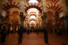 vaults columns inside the Mezquita In Cordoba Spain.