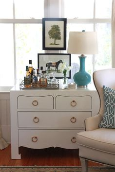 great idea for mini-bar area...and LOVE the framed equestrian print above