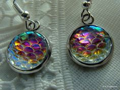Adorable Mermaid Scale Purple Blue Pink White Sparkling Charm Earrings Now Available!  Only 1 pair - $5.00 - Get yours now! Mermaid Scales, Pocket Watch, Pink White, Sparkle, Pairs, Pendant Necklace, Earrings, Blue, Shopping