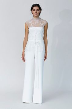 Strapless wide leg jumpsuit by Rivini featuring an intricately embroidered tunic overlay.