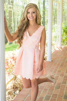This dainty will have you ready for tea time! You won't be able to get over the cuteness of this pink scalloped dress. Cute pink dress features a scalloped v-neckline and hem, pleated skirt and back z                                                                                                                                                      More