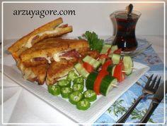 Krok Mösyö (Fransız Tostu) Tarifi - Malzemeler : 10 adet tost ekmeği Kaşar dilimleri Dana jambon yada salam dilimleri (ben sucuk dilimleri kullandım) 2 adet yumurta Yarım çay bardağı süt Tostları bulamak için; galeta unu Kızartmak için; sıvıyağ