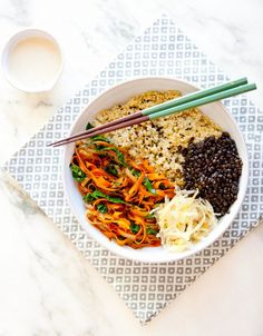 Get Healthy Macro Bowl by A House in the Hills -50% whole grain (quinoa) -35% vegetables (sauteed dino leaf kale and carrot ribbons) -10% beans (beluga lentils) -5% fermented vegetables (saurkraut) -plus some seaweed