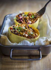 Enchilada Stuffed Spaghetti Squash with black beans, cilantro, corn and bell pepper --keep it vegan or add cheese   www.feastingathome.com