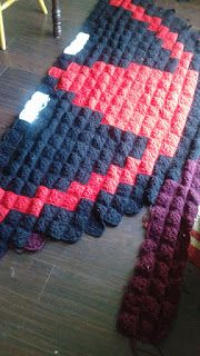 I'm a little over half way done with my husband's crochet pixel Deadpool blanket.
