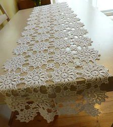 White crochet table runner. I could really see yellow as the color for this. Add a green vase with colorful flowers.