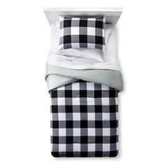 Big bold plaid is a handsome choice in the Checkered Buffalo Comforter Set from Pillowfort. This comforter and sham set takes a traditional white and black plaid and enlarges it for maximum effect.