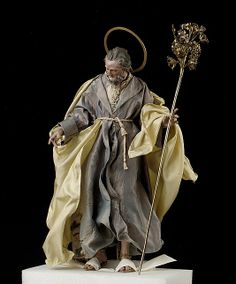 Baroque Neapolitan St. Joseph Figure  Attributed: Salvatore di Franco,18th c.  terracotta head, wooden limbs, silver-  gilt halo and staff.