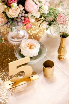 Gold table number | SouthBound Bride | http://www.southboundbride.com/romantic-boho-wedding-at-nooitgedacht-by-vanilla-photography-marisa-anees | Credit: Vanilla Photography