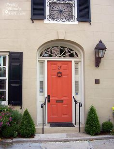Such a wonderful color combo with the color of brick, black shutters and coral door! Iron Doors, Painted Doors, Painted Front Doors, Green Siding, Tan House, Front Door, Entry Doors, House Painting, Shutter Colors